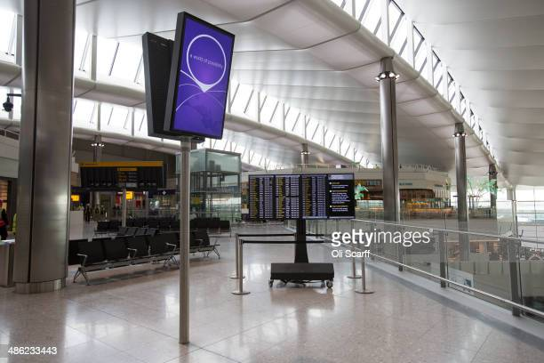 A sign is displayed in the underconstruction departure lounge of Heathrow airport's new Terminal 2 on April 23 2014 in London England The rebuilding...