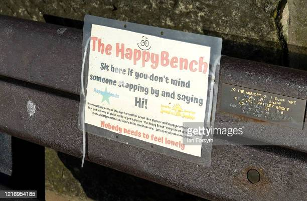Sign is displayed on a bench in Whitby as visitors observe the guidelines during the Coronavirus pandemic lockdown on April 05, 2020 in Whitby,...