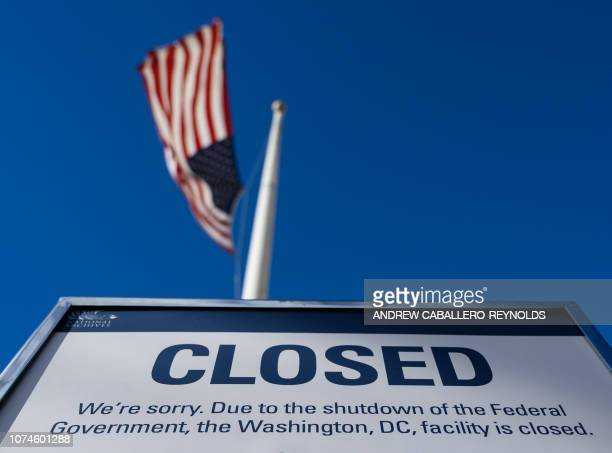 Sign is displayed on a government building that is closed because of a US government shutdown in Washington, DC, on December 22, 2018. - The partial...