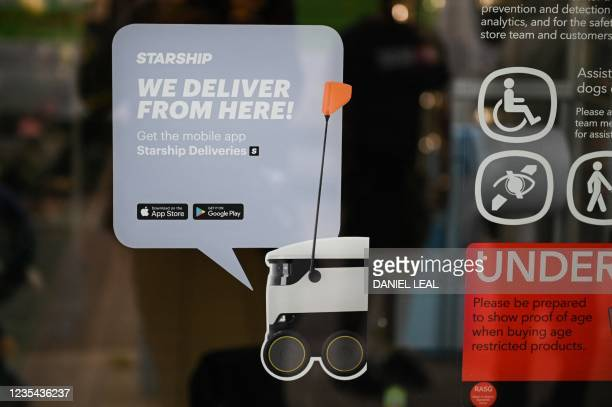 Sign is displayed on a local Co-op supermarket about an autonomous robot called Starship which delivers groceries in Milton Keynes, England on...