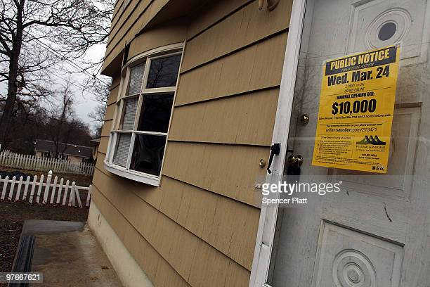 A sign is displayed on the door of a foreclosed home on March 12 2010 in Bridgeport Connecticut A new report by RealtyTrac Inc announced that the...
