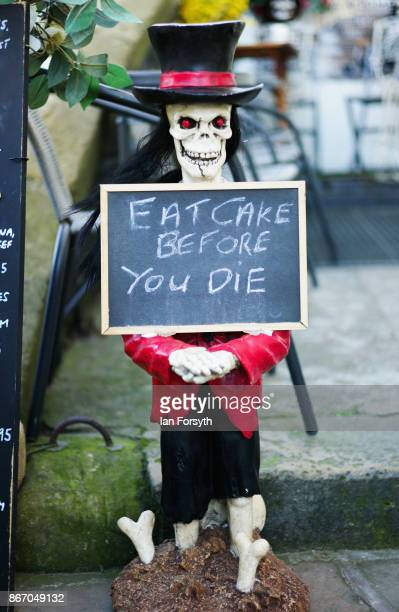 Sign is displayed outside a cafe during the Whitby Goth Weekend on October 27, 2017 in Whitby, England. The Whitby Goth Weekend began in 1994 and...
