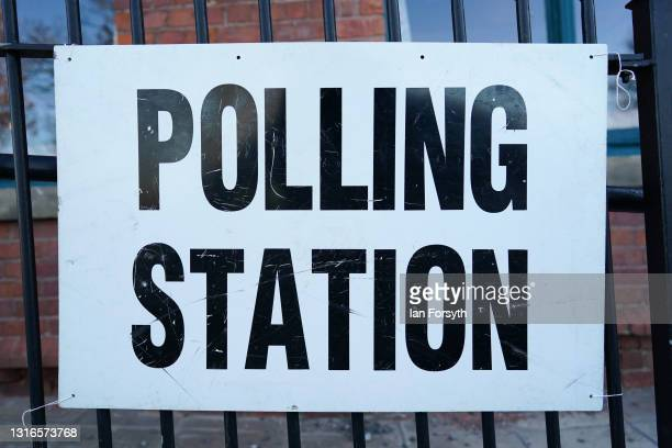 Sign is displayed outside a polling station as voting begins in the Hartlepool by-election on May 06, 2021 in Hartlepool, England. Today voters in...
