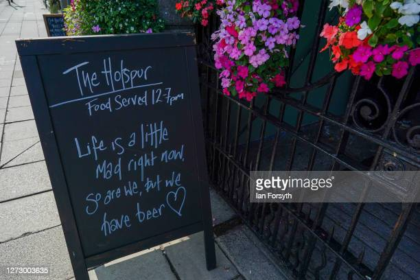 A sign is displayed outside a pub in Newcastle on September 17 2020 in Newcastle upon Tyne England Almost two million people in northeast England...