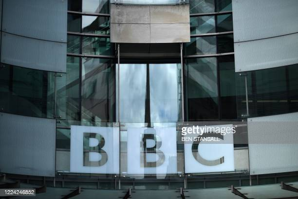Sign is displayed outside the BBC headquarters in Portland Place, London on July 2, 2020. - The BBC announced on Thursday its intention to cut 450...