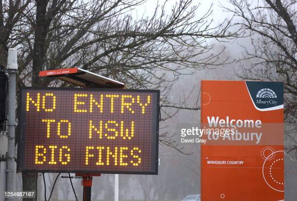 Sign is displayed regarding COVID-19 restrictions in the New South Wales , Victoria border town of Albury on July 7, 2020 in Australia. The...