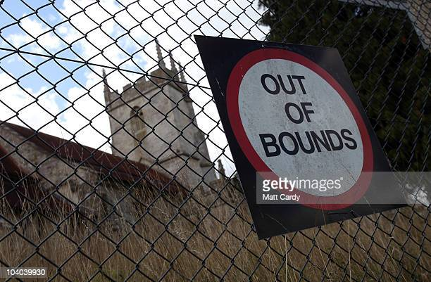 A sign is displayed to a fence surrounding the church of St Giles in the village of Imber on September 12 2010 near Warminster England The village...