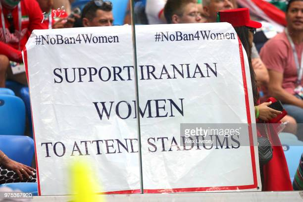 A sign is held by fans in support of Iranian women in football during the 2018 FIFA World Cup Russia group B match between Morocco and Iran at Saint...