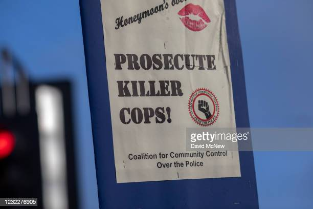 Sign is held by one of the people gathered at the intersection of Florence and Normandie to protest the fatal police shooting of Daunte Wright in...