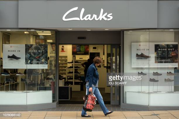 Sign is pictured above the entrance to a branch of the shoe retailer Clarks in the town centre of Darlington, northern England on September 6, 2018.