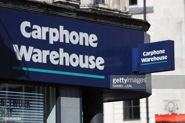 A sign is pictured above the entrance to a Carphone Warehouse mobile phone shop in London on September 17 2018
