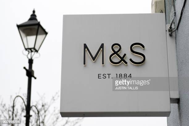 A sign is pictured at a branch of Marks and Spencer supermarket in west London on January 9 2018 / AFP PHOTO / Justin TALLIS
