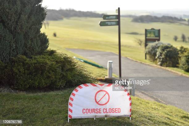 A COURSE CLOSED sign is pictured at Dyke Golf Club north of Brighton in southern England on March 31 as life in Britain continues during the...