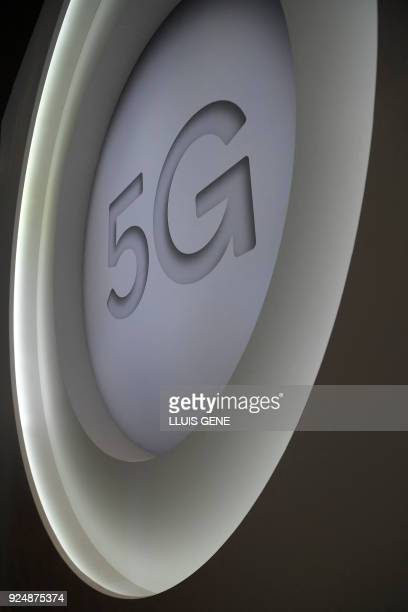 A 5G sign is pictured at the Quantum stand of the Mobile World Congress the world's biggest mobile fair on February 27 2018 in Barcelona The Mobile...