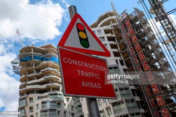 A sign is pictured by new apartments and a retail complex under construction at the Battersea Power Station redevelopment site in south London on...