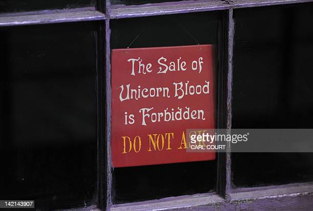 A sign is pictured in the window of a shop in Diagon Alley during a preview of the Warner Bros Harry Potter studio tour 'The Making of Harry Potter'...