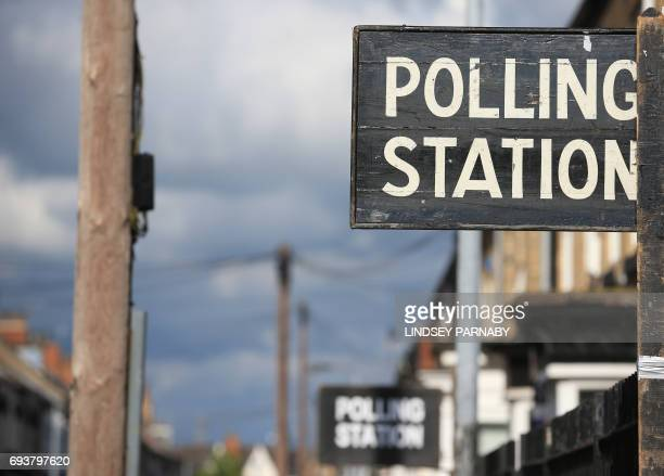 A sign is pictured outside a polling station in KingstonUponHull northern England on June 8 2017 as Britain votes in the general election Polls...