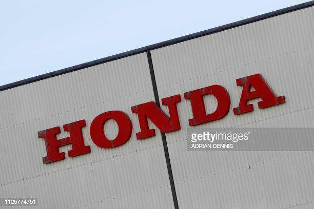 A sign is pictured outside of the Honda manufacturing plant in Swindon southwest England on February 19 2019 Honda announced Tuesday it would shut a...