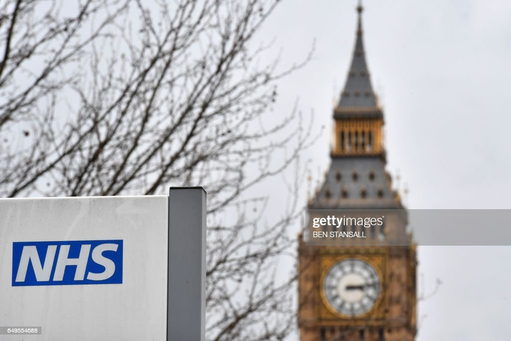 sign is pictured outside St Thomas' Hospital, near the Houses of Parliament, in central London on March 8, 2017. Britain's economy will grow by 2.0 percent this year, sharply up on a previous forecast of 1.4 percent, finance minister Philip Hammond said Wednesday in his budget statement. Hammond also announced a two billion pound increase in spending for social care, over the next three years, in an effort to tackle pressure on the NHS. /
