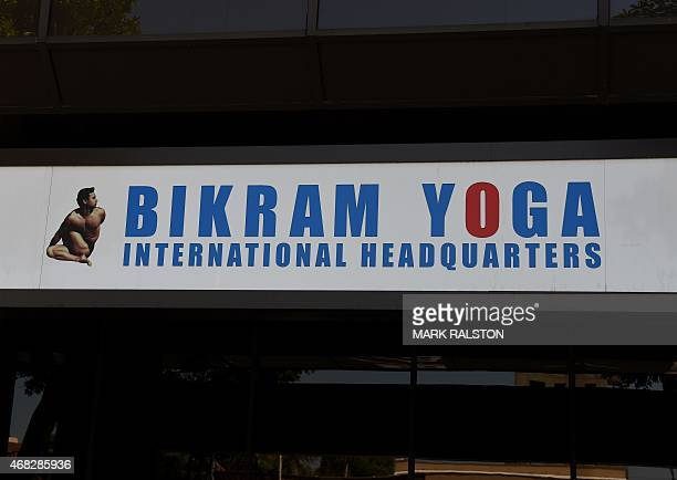 A sign is pictured outside the commercial building containing the headquarters of Bikram Yoga in Los Angeles California on April 1 2015 Yoga guru...