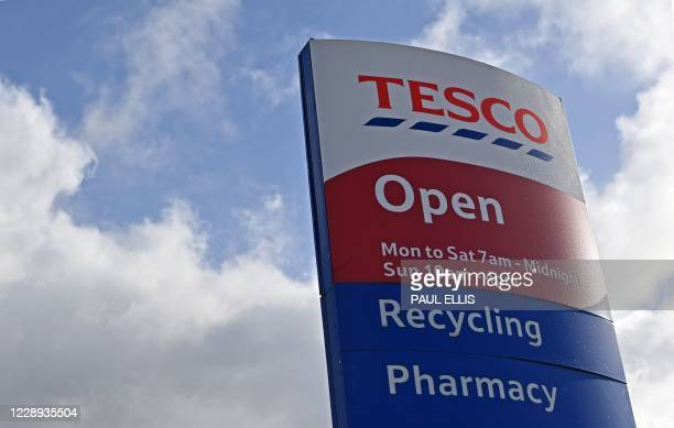 A sign is pictured outside the entrance to a Tesco supermarket in Liverpool north west England on October 7 2020 Britain's biggest retailer...