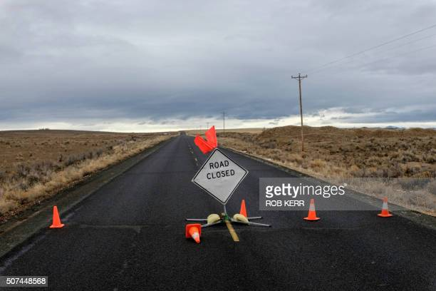 A sign is placed on a closed road to the occupied federal wildlife refuge near Burns Oregon on January 29 a day after the FBI released video showing...
