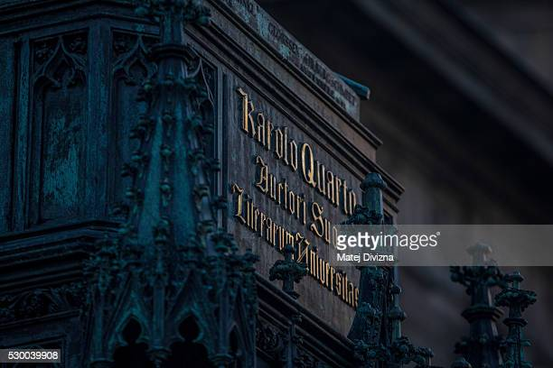 A sign is placed on the statue of ruler Charles IV which stands next to the Charles Bridge on May 10 2016 in Prague Czech Republic The Charles Bridge...