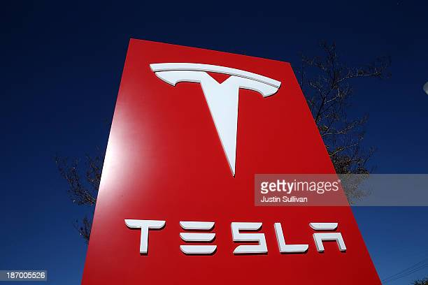 A sign is posted at a Tesla showroom on November 5 2013 in Palo Alto California Tesla will report third quarter earnings today after the closing bell