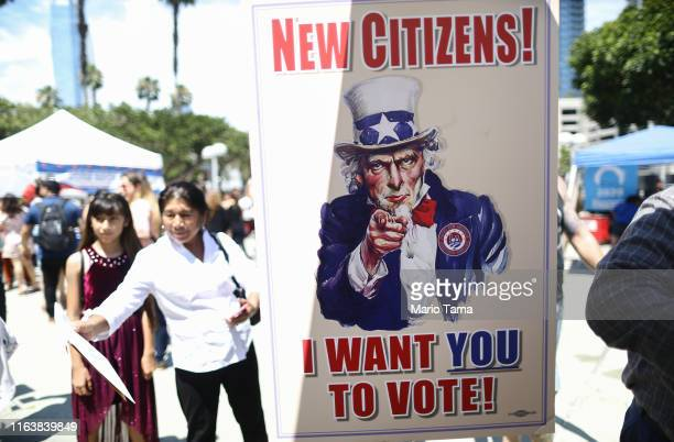 A sign is posted at a voter registration booth outside a naturalization ceremony at the Los Angeles Convention Center on July 23 2019 in Los Angeles...