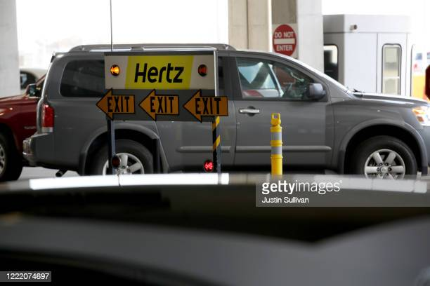 A sign is posted at the Hertz RentACar rental lot at San Francisco International Airport on April 30 2020 in San Francisco California According to a...