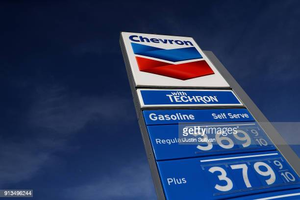 A sign is posted in front of a Chevron gas station on February 2 2018 in Mill Valley California Chevron reported fourth quarter earnings that missed...