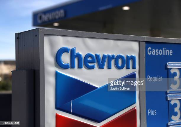 A sign is posted in front of a Chevron gas station on February 2 2018 in Corte Madera California Chevron reported fourth quarter earnings that missed...
