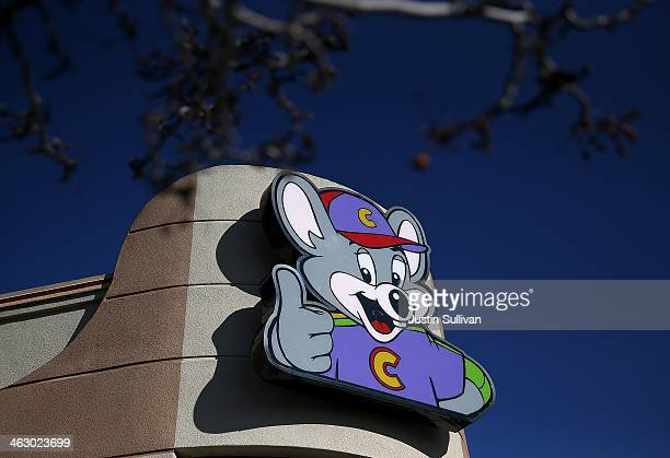A sign is posted in front of a Chuck E Cheese restaurant on January 16 2014 in Newark California CEC Entertainment operator of 577 kidthemed...