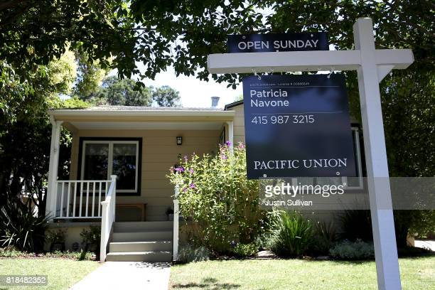 A sign is posted in front of a home for sale on July 18 2017 in San Anselmo California California is experiencing a housing crisis with a low number...