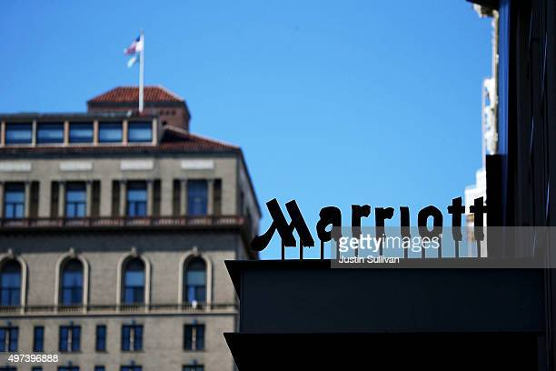 A sign is posted in front of a Marriott hotel on November 16 2015 in San Francisco California Marriott International announced plans to purchase...