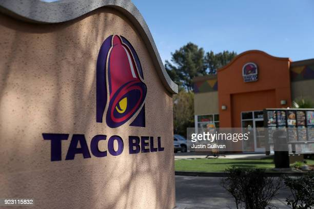 A sign is posted in front of a Taco Bell restaurant on February 22 2018 in Novato California Taco Bell has become the fourthlargest domestic...