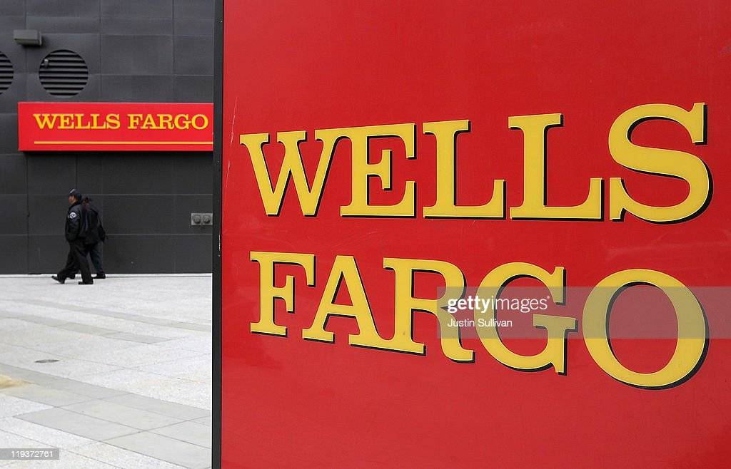 A sign is posted in front of a Wells Fargo Bank branch on July 19, 2011 in Oakland, California. San Francisco-based Wells Fargo & Co. reported a 30 percent surge in quarterly profits with earnings of $3.73 billion, or 70 cents per share compared to $2.88 billion, or 55 cents per share one year ago.