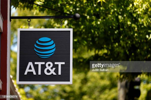 Sign is posted in front of an AT&T retail store on May 17, 2021 in San Rafael, California. AT&T, the world's largest telecommunications company,...