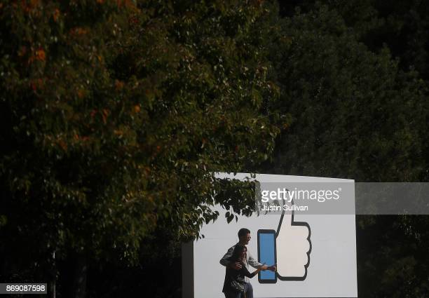 A sign is posted in front of Facebook headquarters on November 1 2017 in Menlo Park California Facebook is expected to report third quarter earnings...