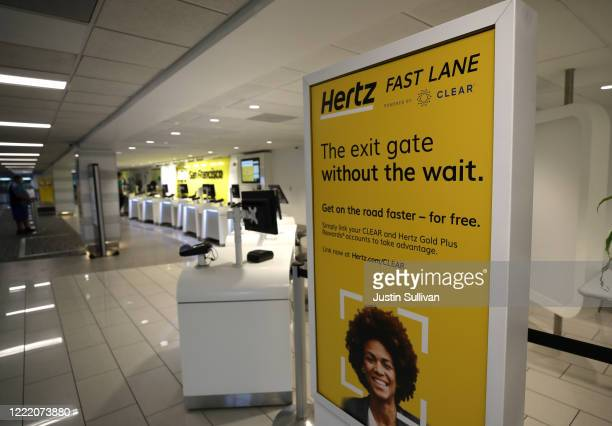 A sign is posted in the entrance to the Hertz RentACar desk at San Francisco International Airport on April 30 2020 in San Francisco California...