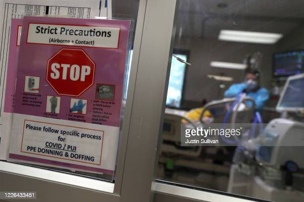 Sign is posted in the window of a coronavirus COVID-19 patient's room in the intensive care unit at Regional Medical Center on May 21, 2020 in San...