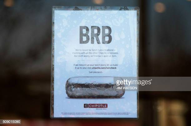 A sign is posted in the window of Chipotle Mexican Grill in Bowie Maryland advising customers they will be closed for a company wide meeting on...