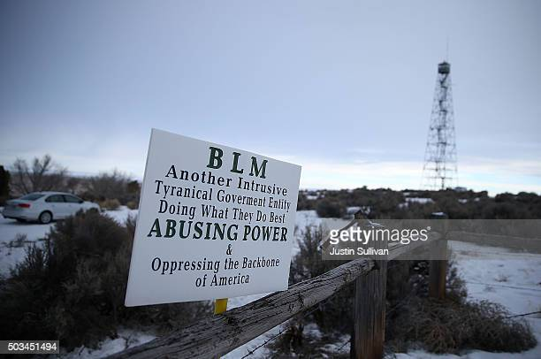 A sign is posted on a fence at the Malheur National Wildlife Refuge Headquarters on January 5 2016 near Burns Oregon An armed antigovernment militia...