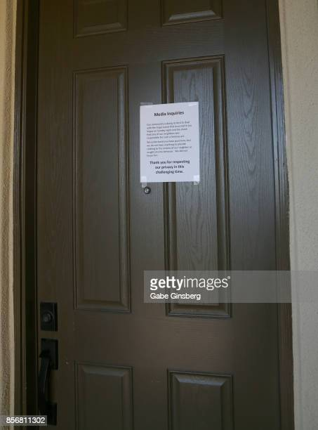 A sign is posted on a neighbor's door next to the house where suspected Las Vegas gunman Stephen Paddock lived on October 2 2017 in Mesquite Nevada...