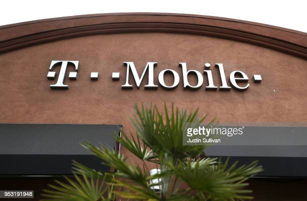 A sign is posted on the exterior of a TMobile store on April 30 2018 in El Cerrito California TMobile announced plans to acquire Sprint for $26...