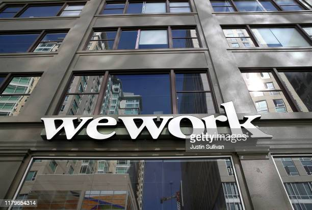 Sign is posted on the exterior of a WeWork office on October 07, 2019 in San Francisco, California. Days after withdrawing its registration for an...