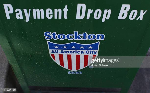 Sign is posted on the side of a utility bill payment box outside of Stockton City Hall on June 27, 2012 in Stockton, California. Members of the...
