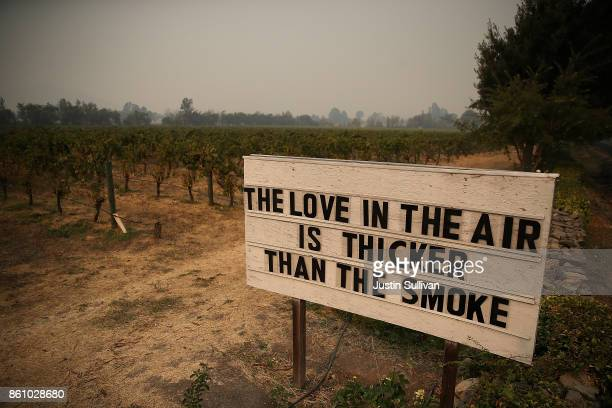 A sign is posted outside Cline Cellars on October 13 2017 in Sonoma California At least thirty one people have died in wildfires that have burned...