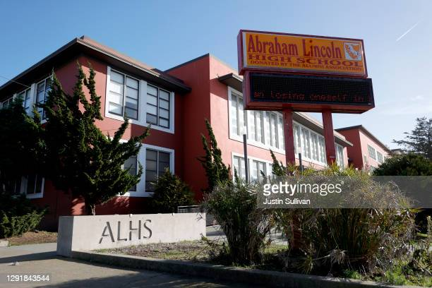 Sign is posted outside of Abraham Lincoln High School on December 17, 2020 in San Francisco, California. A San Francisco school names advisory...