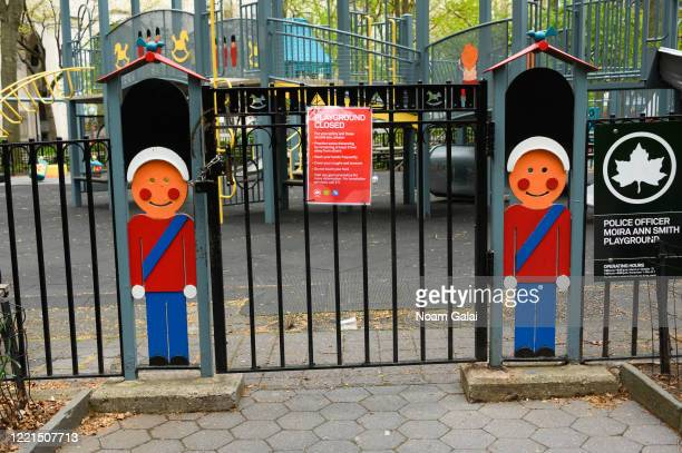 Sign is posted outside the closed Moira Ann Smith playground at Madison Square Park during the coronavirus pandemic on April 27, 2020 in New York...